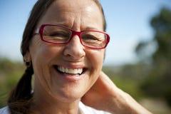 Lächelnde fällige Frau. Stockbild