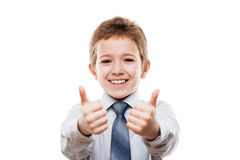 Lächelnder junger Geschäftsmannkinderjunge, der Daumen herauf Erfolg s gestikuliert Stockfotos