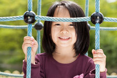 Lächelndes asiatisches Mädchen Stockfoto