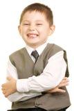 Lächelndes Kind in der Weste Stockfoto