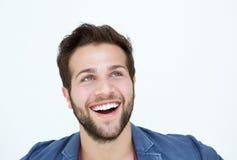 Lächelndes Manngesicht auf weißem Hintergrund Stockbild