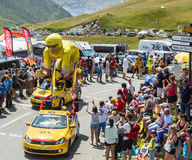 LCL Caravan in Alps - Tour de France 2015. Col du Glandon, France - July 23, 2015: LCL characteristic vehicles during the passing of the Publicity Caravan on Col Stock Photography