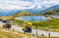LCL Caravan in Alps - Tour de France 2015. Col de la Croix de Fer, France - 25 July 2015: LCL caravan driving on the road to the Col de la Croix de Fer in Alps Stock Photos