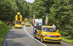 LCL Caravan During Le Tour de France 2014. Col de Platzerwasel, France - July 14, 2014: The specific caravan of vehicles passing in front of the audience on the Royalty Free Stock Images