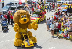 LCL Lion Mascot in Alps - Tour de France 2015. Col du Glandon, France - July 23, 2015: LCL characteristic vehicle during the passing of the Publicity Caravan on Stock Photo