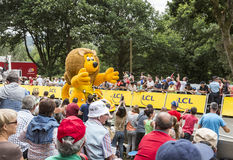 LCL Lion Mascot - Tour de France 2015. Plumelec, France - 12 July, 2015: Lion shaped LCL car during the passing of the Publicity Caravan before the Team Time Royalty Free Stock Photos