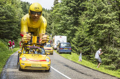 LCL Yellow Cyclist Mascot. Col de Platzerwasel, France - July 14, 2014: The specific LCL yellow mascot during the passing during the Publicity Caravan in front Stock Photo