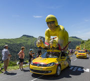 LCL Yellow Cyclist Mascot - Tour de France 2016. Pas de Peyrol, France - July 6,2016: The specific LCL yellow mascot during the passing of the Publicity Caravan Royalty Free Stock Image