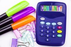 LCommunity tekst w biurze z otoczeniami tak jak markier, pióra writing na kalkulatorze Biznesowy pojęcie dla więź bielu Zdjęcia Royalty Free