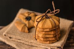 LCookies. Cookies - Chocolate chip cookies stack tied with brown rope on on the hessian napkin background Stock Image
