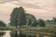 Ld shed by the lake. Landscape view and old shed, small bridge and trees by the lake Royalty Free Stock Photography