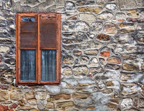 Оld weathered cement wall exposing broken bricks background wit Stock Photo