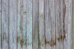 ?ld wooden fence. Shabby old wooden fence with paint traces Royalty Free Stock Image