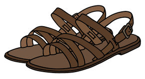 Läderkvinnas sandaler Arkivbilder