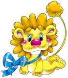Leão pequeno alegre com um dar Fotografia de Stock Royalty Free