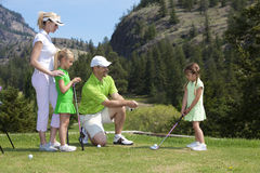 Leçon de golf de famille Images libres de droits
