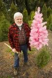 Leñador con la Navidad rosada y el hacha Foto de archivo