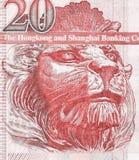 León británico en el fragmento del primer viejo del billete de banco de veinte Hong Kong Dollars imagen de archivo libre de regalías