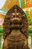 León de piedra del oro Imagenes de archivo