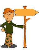 Leśniczy chłopiec trzyma znaka Obrazy Royalty Free