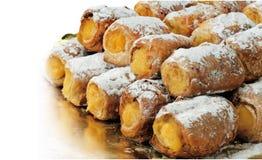 """le  d'""""Canutillos†a rempli de la crème de pâtisserie et de sucre glace photos libres de droits"""