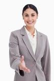 Le affärskvinna som erbjuder henne handen Arkivfoto