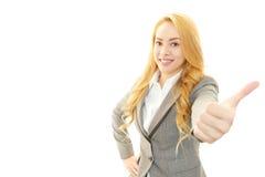 Le affärskvinnan med tummar upp fotografering för bildbyråer