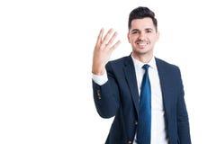 Le affärsmannen eller försäljningsmanvisning numrera fyra Arkivfoton