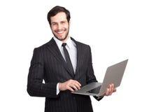 Le affärsmannen med en bärbar dator arkivfoto