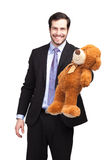 Le affärsmannen med nallebjörnen royaltyfria bilder