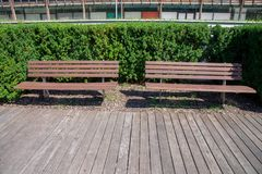 Urban furniture in a public park Trento, Italy. Wooden benches and catwalk. Residential district Le Albere, designed by the Itali stock photography