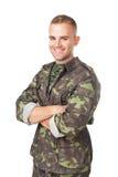 Le armésoldaten med hans korsade armar Arkivbilder