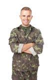 Le armésoldaten med hans korsade armar Arkivfoton
