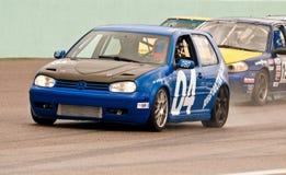 Le automobili combattono per la posizione di palo Fotografia Stock