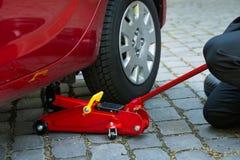 Le automobili hanno tolto la terra per riparare Fotografie Stock
