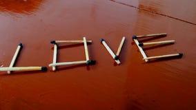 Le bâton de match conçoit l'amour de mot Photo libre de droits