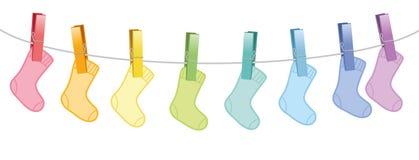 Le bébé cogne la corde à linge ensemble de laine coloré illustration libre de droits