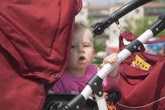 Le bébé dans la poussette Images libres de droits