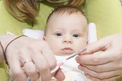 Le bébé de coupe-ongles Photographie stock