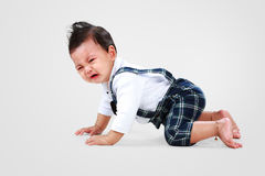 Le bébé garçon fixent à pleurer Image stock