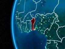 Le Bénin sur terre la nuit Images stock