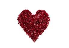 Le bacche di un melograno in un cuore modellano Immagini Stock Libere da Diritti
