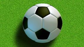 Le ballon de football de roulement sur le champ banque de vidéos