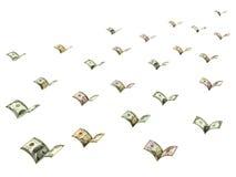 Le banconote alate del dollaro stanno volando Fotografie Stock Libere da Diritti