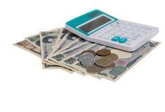 le banconote giapponesi di Yen di valuta con Yen giapponesi coniano e caloria Immagine Stock