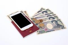 Le banconote giapponesi di Yen di valuta con Yen giapponesi coniano, telefonano la a Fotografia Stock Libera da Diritti