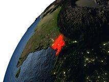 Le Bangladesh en rouge sur terre la nuit Photo libre de droits