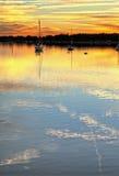 Le barche si sono messe in bacino al hdr di tramonto Fotografia Stock