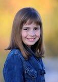 le barn för brunettflicka Royaltyfri Bild