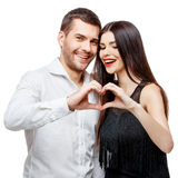 le barn för härlig stående för par lycklig arkivbild